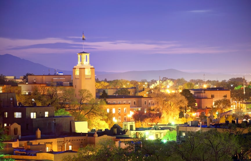 A view from a rooftop of Santa Fe lit up at night