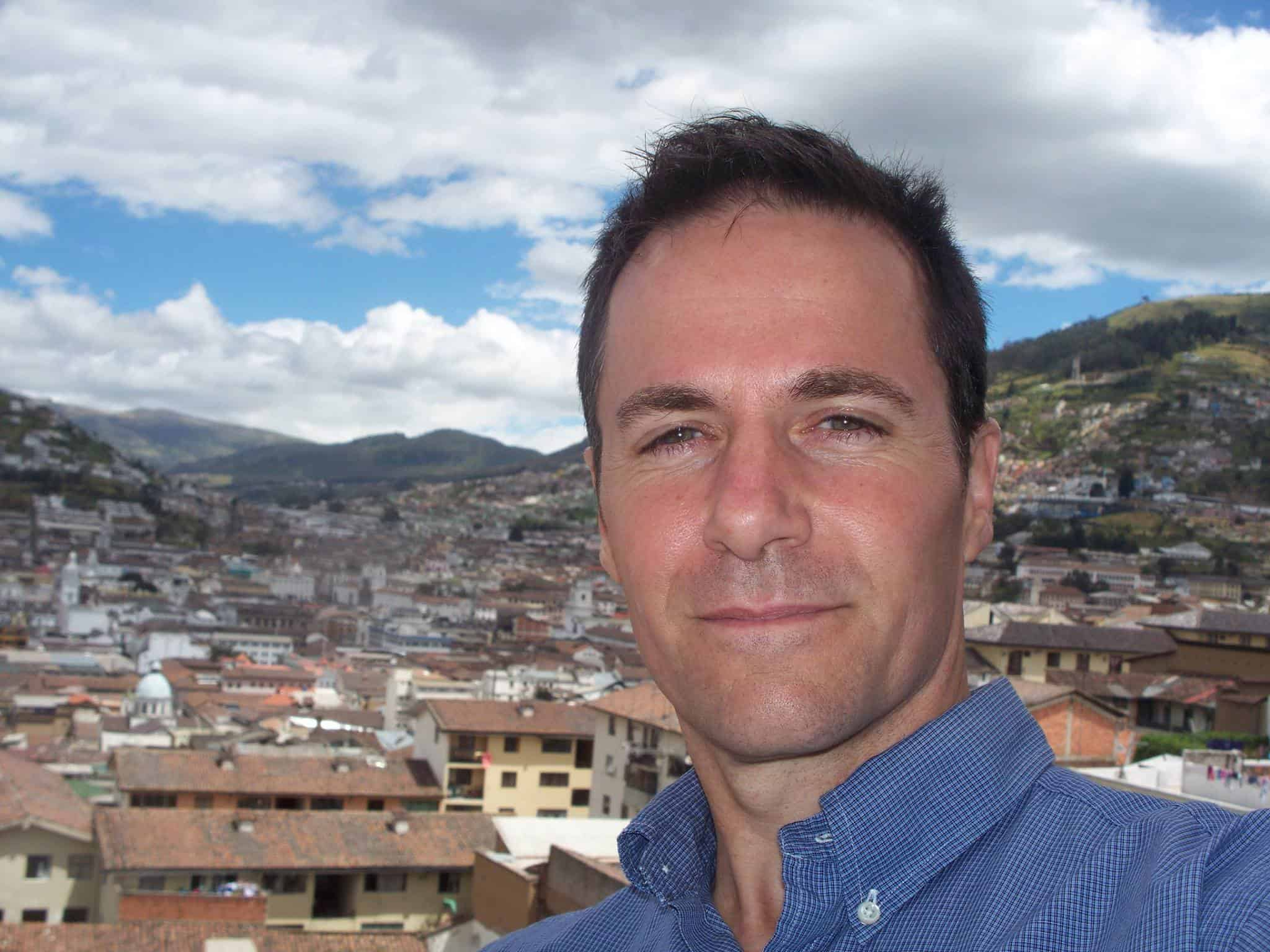 Steve Roller taking a selfie overlooking the city of Quito, Ecuador