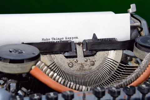 A type writer that just had typed on it the words Make Things Happen