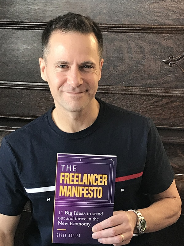 Steve holding his book The Freelancer Manifesto